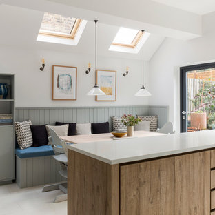 Inspiration For A Classic Kitchen Diner In London With Flat Panel Cabinets Light