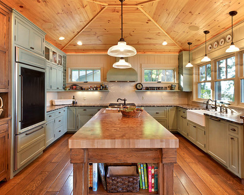 Mountain Style Kitchen Photo In Other With A Farmhouse Sink, Green Cabinets  And Paneled Appliances