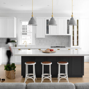 Inspiration for a large traditional l-shaped open plan kitchen in Sydney with a submerged sink, shaker cabinets, grey cabinets, engineered stone countertops, grey splashback, ceramic splashback, stainless steel appliances, light hardwood flooring, an island, beige floors and yellow worktops.