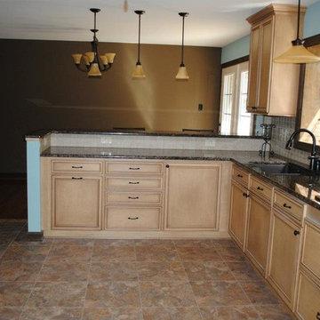 Duraceramic Floors, Baltic Brown Granite, Maple Cabinets