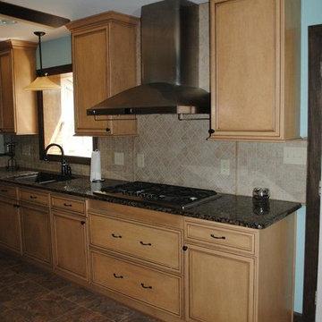 Duraceramic Floors, Maple Cabinets, Baltic Brown Granite with Tile Backsplash