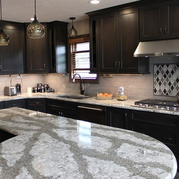 DuraSupreme Peppercorn Kitchen With Cambria Tops and Black Stainless Appliances