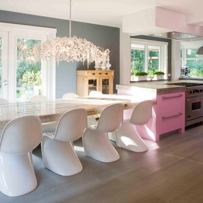 Inspiration for a large contemporary l-shaped medium tone wood floor eat-in kitchen remodel in New York with flat-panel cabinets, stainless steel appliances, an undermount sink, concrete countertops and an island