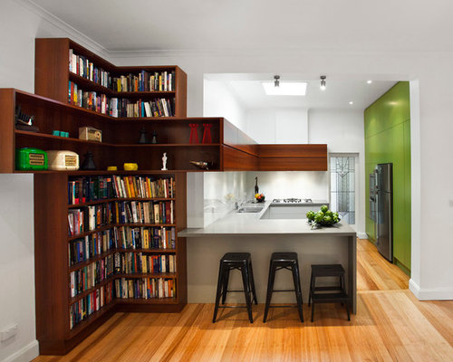 Example of a mid-sized trendy u-shaped light wood floor kitchen design in