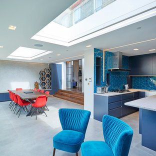 Inspiration for a medium sized contemporary u-shaped kitchen/diner in London with flat-panel cabinets, quartz worktops, ceramic splashback, integrated appliances, ceramic flooring, an island, grey floors, grey worktops, a belfast sink, blue cabinets and blue splashback.