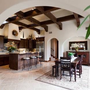 Design ideas for a mid-sized mediterranean single-wall eat-in kitchen in San Luis Obispo with shaker cabinets, medium wood cabinets, limestone benchtops, multi-coloured splashback, slate splashback, stainless steel appliances, travertine floors, with island and beige floor.