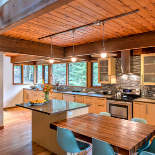 Large rustic eat-in kitchen ideas - Large mountain style single-wall bamboo floor eat-in kitchen photo in Boston with an undermount sink, flat-panel cabinets, light wood cabinets, multicolored backsplash, matchstick tile backsplash, stainless steel appliances and two islands