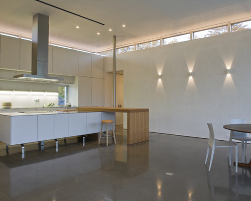 Minimalist Eat In Kitchen Photo In New York With Flat Panel Cabinets And  White