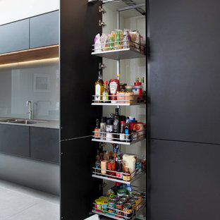 Example of a large minimalist kitchen pantry design in Belfast