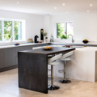 Photo of a large contemporary l-shaped kitchen in Other with flat-panel cabinets, grey cabinets, quartz worktops, white splashback, porcelain flooring, an island, beige floors and white worktops.