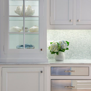 Inspiration for a small coastal galley light wood floor enclosed kitchen remodel in New York with shaker cabinets, white cabinets and stainless steel appliances