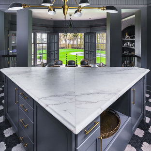 Small transitional l-shaped separate kitchen in New York with a double-bowl sink, quartz benchtops, grey splashback, mosaic tile splashback, recessed-panel cabinets, grey cabinets, marble floors, with island, black appliances and multi-coloured floor.