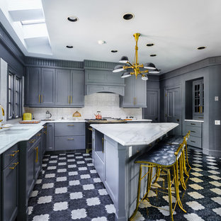 Inspiration for a small transitional l-shaped separate kitchen in New York with a double-bowl sink, quartz benchtops, grey splashback, mosaic tile splashback, black appliances, shaker cabinets, grey cabinets, with island, ceramic floors and multi-coloured floor.