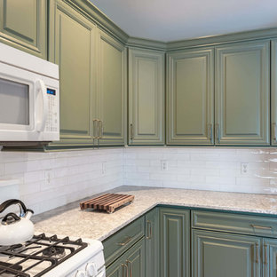 Design ideas for a mid-sized u-shaped eat-in kitchen in New York with an undermount sink, raised-panel cabinets, green cabinets, quartz benchtops, white splashback, ceramic splashback, white appliances, plywood floors, with island and beige floor.