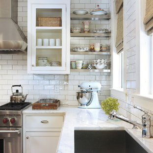 Photo of a traditional kitchen in Providence with beaded cabinets, stainless steel appliances, a single-bowl sink, white cabinets, marble worktops, white splashback and metro tiled splashback.