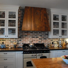 Traditional Kitchen by Extraordinary League Contracting