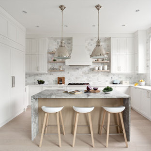 Design ideas for a small transitional u-shaped eat-in kitchen in Vancouver with a single-bowl sink, shaker cabinets, white cabinets, quartz benchtops, ceramic splashback, stainless steel appliances, plywood floors, with island, beige floor, grey splashback and white benchtop.