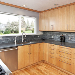 Photo of a contemporary kitchen in Seattle with stainless steel appliances and slate splashback.