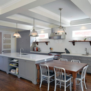 Design ideas for a large modern galley eat-in kitchen in Ottawa with an integrated sink, recessed-panel cabinets, grey cabinets, quartzite benchtops, white splashback, subway tile splashback, stainless steel appliances, medium hardwood floors and with island.