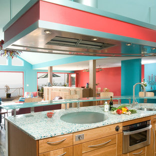 Large contemporary single-wall open plan kitchen in Seattle with an undermount sink, open cabinets, light wood cabinets, recycled glass benchtops, blue splashback, subway tile splashback, stainless steel appliances, medium hardwood floors, with island and turquoise benchtop.
