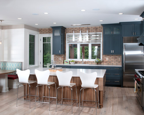 Contemporary l-shaped medium tone wood floor eat-in kitchen idea in Grand  Rapids
