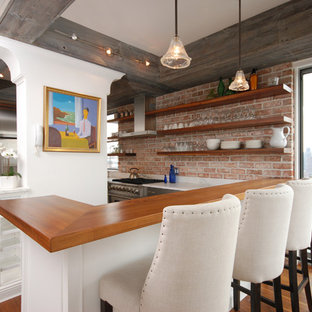 Eclectic kitchen photos - Eclectic kitchen photo in New York with wood countertops