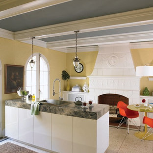Eclectic kitchen pictures - Kitchen - eclectic kitchen idea in Boise with a drop-in sink and laminate countertops
