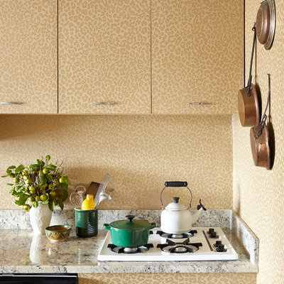 Eclectic kitchen photo in New York with flat-panel cabinets
