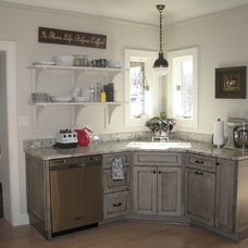 eclectic kitchen by Geneva Cabinet Company