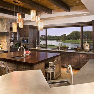 Rustic kitchen in Minneapolis with stainless steel appliances.