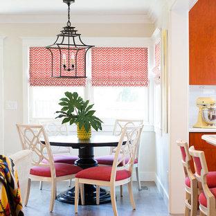 Mittelgroße Stilmix Wohnküche mit flächenbündigen Schrankfronten, orangefarbenen Schränken, Küchenrückwand in Weiß, Rückwand aus Metrofliesen, Kücheninsel und Keramikboden in Sacramento