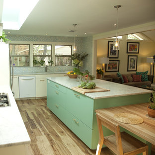 Photo of an eclectic kitchen in Austin with marble benchtops, white appliances, flat-panel cabinets and turquoise cabinets.