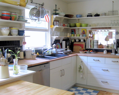 Eclectic Kitchen Photo In Burlington With Wood Countertops, Open Cabinets  And A Drop In