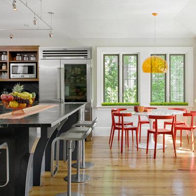 Elegant eat-in kitchen photo in Boston with soapstone countertops