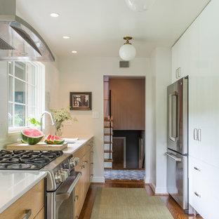 Photo of a mid-sized midcentury galley separate kitchen in DC Metro with an undermount sink, quartzite benchtops, white splashback, ceramic splashback, stainless steel appliances, dark hardwood floors and no island.