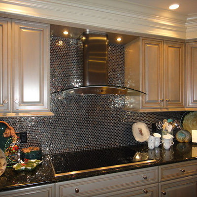 Example of a mid-sized eclectic l-shaped medium tone wood floor open concept kitchen design in Little Rock with an undermount sink, gray cabinets, granite countertops, metallic backsplash, glass tile backsplash, stainless steel appliances and an island