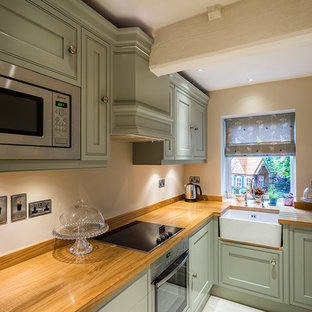 Inspiration For A Small Traditional L Shaped Enclosed Kitchen With A  Belfast Sink, Shaker