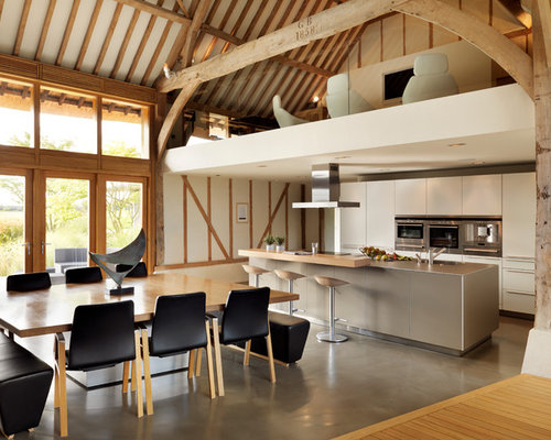 Contemporary open concept kitchen idea in Cheshire with an island