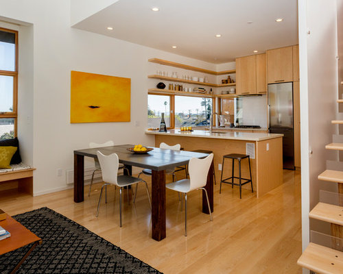 Contemporary open concept kitchen inspiration - Example of a trendy galley  medium tone wood floor and