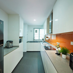 Inspiration for a small modern l-shaped kitchen pantry in Singapore with flat-panel cabinets, beige cabinets, marble benchtops, orange splashback and multiple islands.