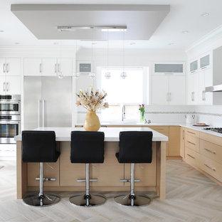 Large contemporary l-shaped kitchen in Vancouver with an undermount sink, flat-panel cabinets, quartz benchtops, white splashback, porcelain splashback, stainless steel appliances, porcelain floors, with island, white benchtop, white cabinets and beige floor.