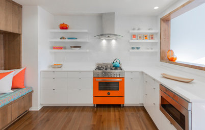 Eye-Popping Orange Range Warms Up a Sleek White Kitchen