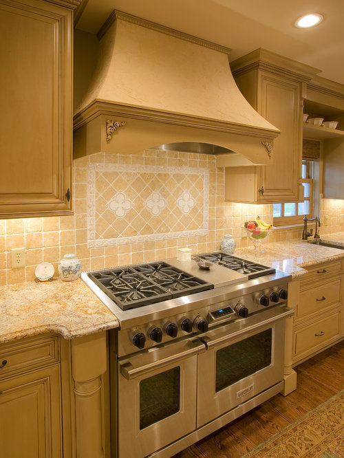 Example Of A Mid Sized Classic Galley Medium Tone Wood Floor Enclosed  Kitchen Design In