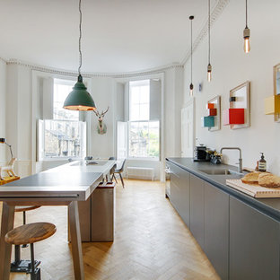 Photo of a large eclectic kitchen/diner in Edinburgh with laminate countertops, stainless steel appliances, an island and grey worktops.