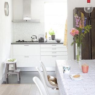 Kitchen - modern kitchen idea in Amsterdam with white backsplash, mosaic tile backsplash, flat-panel cabinets and white cabinets