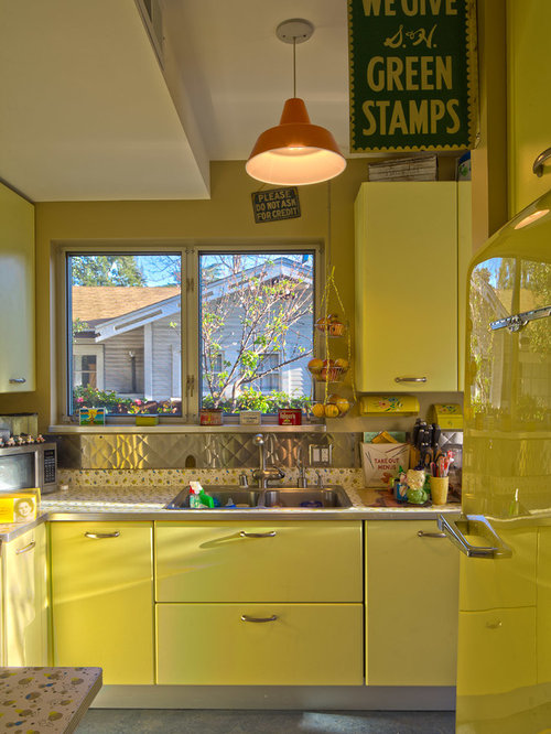 Eclectic Kitchen Idea In Los Angeles With Yellow Cabinets, Metallic  Backsplash And Metal Backsplash