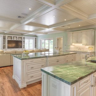 Open concept kitchen - traditional open concept kitchen idea in Miami with raised-panel cabinets, white cabinets and green countertops