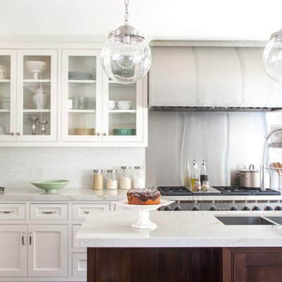 Eat-in kitchen - mid-sized traditional l-shaped medium tone wood floor eat-in kitchen idea in Los Angeles with an undermount sink, beaded inset cabinets, white cabinets, white backsplash, stainless steel appliances, an island, marble countertops and stone tile backsplash