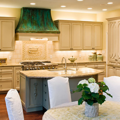 Inspiration for a timeless eat-in kitchen remodel in Austin with an undermount sink, raised-panel cabinets, beige cabinets, granite countertops and beige backsplash