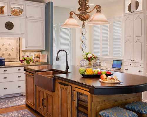 Elegant Kitchen Photo In Austin With A Double Bowl Sink Raised Panel Cabinets